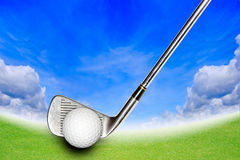 Golf Stick and Ball on the Green Grass Stock Images