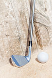 Golf stick and ball on the sand. Royalty Free Stock Photos