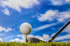 Golf stuff on sunny golf field Royalty Free Stock Images