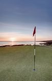 Golf sunrise - Castle Course, St Andrews. The sun rising over the sea from the new Castle Course in St Andrews stock photography