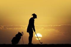 Golf at sunset Royalty Free Stock Image