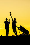 Golf Sunset Silhouette. On the orange sky Stock Images