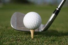 Golf swing!. Trying to hit a hole in one Royalty Free Stock Photos