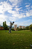 Golf swing. Beautiful day for a game of golf swing Stock Photo