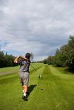 Golf Swing. A man tees off on a summer's afternoon stock photo