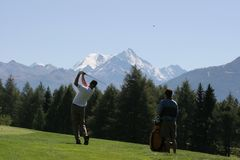 Golf swing in Crans-Montana Stock Images