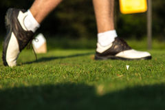 Golf swing finish. Young golfer finishes swing in good form Stock Photography