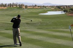 Golf swing in palm springs. Millenium course, hole 10 Royalty Free Stock Images