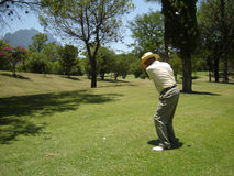 Golf Swing Shoot. Senier man make a golf shoot Royalty Free Stock Photography