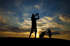 Golf Swing Silhouette. Male golfer playing golf at sunset Royalty Free Stock Photos