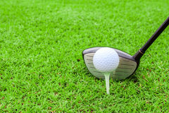 Golf tee ball club driver in green grass course preparing to sho Stock Photo