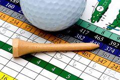 Golf tee, ball and scorecard Royalty Free Stock Images