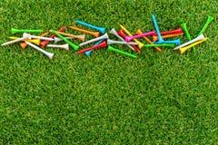 Golf tee on grass Stock Photo