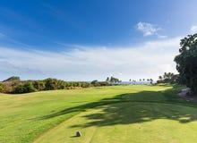 Golf tee marker on fairway overlooking ocean in Lihue Kauai Royalty Free Stock Image