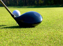 Golf - Tee Off. Close-up of a driver and a ball on 1st tee Royalty Free Stock Image