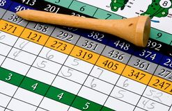 Golf tee and scorecard. A golf tee on a completed golf scorecard Stock Photography