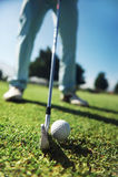 Golf tee shot. Closeup of golfer with iron hitting tee shot Royalty Free Stock Photo