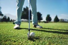 Golf tee shot. Closeup of golfer with iron hitting tee shot Royalty Free Stock Images