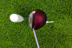 Golf tee shot with driver. Photo of a driver hitting a golf ball off the tee with motion blur on the club and ball. Actual shot not photoshopped in Royalty Free Stock Image