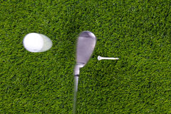 Golf tee shot with iron. Photo of an iron hitting a golf ball off the tee with motion blur on the club and ball. Actual shot not photoshopped in stock images