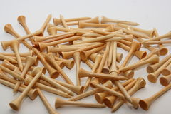 Golf tees. Wooden golf tees on a white background Stock Photos