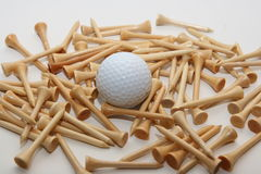 Golf tees and ball. Wooden golf tees with golf ball on a white background Stock Photography