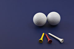 Golf and tees on blue Stock Photography