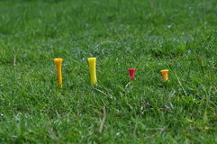 Four fore golf tees in lawn. Close up of four fore different golf tees in lawn big small Stock Photos