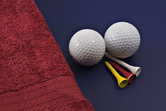 Golf and tees and towels Royalty Free Stock Photography
