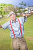 Golf Temper Tantrum. Irritable Golfer Throws A Fit Of Rage On A Landscape Grassy Green Golf Course Breaking His Golfing Stick When Throwing A Golf Temper Tantrum Stock Photos