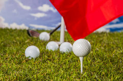 Golf theme on green grass and sky background Royalty Free Stock Image