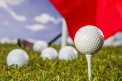 Golf theme on green grass and sky background Stock Image