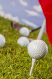 Golf theme on green grass and sky background Stock Photography