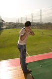 Golf training. Man training, playing golf on the green Royalty Free Stock Image
