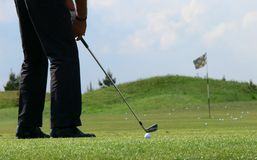 Golf training. Golf player training on the grass field Stock Photography