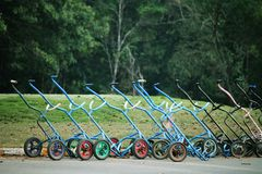 Golf trolley in evening golf course has sunlight shining down at. Golf course in Thailand Stock Photography