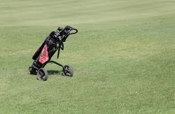 Golf trolleys. A golf trolley seen on the green during a companies golf tournament in the spanish island of mallorca Stock Images