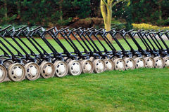 Golf trolleys. Photo of golf trolleys in a line Royalty Free Stock Image