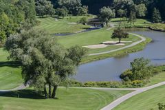 Golf. A typical golf course on a sunny day Stock Images