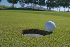 Golf unsunk putt on the lip royalty free stock images
