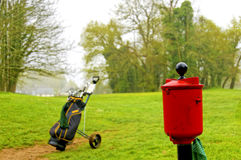 Golf wash. A red ball wash with caddie on the golf par Royalty Free Stock Image
