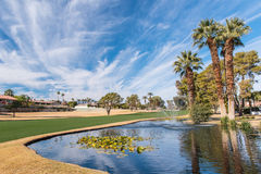 Golf water hazard with a fountain and trees Stock Photo