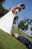 Golf and wedding. Bride and groom playing golf Stock Image