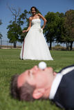Golf and wedding. Bride and groom playing golf Stock Photo