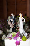 Golf Wedding Cake Toppers. Funny wedding cake toppers featuring a golfing groom and his sassy bride Royalty Free Stock Image