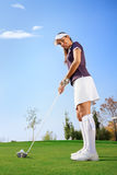 Golf woman player golf. Golf woman player green putting hole golf ball Royalty Free Stock Photos