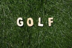 Golf Wooden Sign On Grass. Golf wooden sign  on green grass background Stock Photos