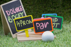 Golf wording term sign with golf ball are on green grass Stock Image