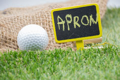 Golf wording term sign with golf ball are on green grass Stock Images