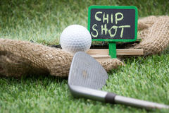 Golf wording term sign with golf ball are on green grass Stock Photography